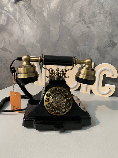 Téléphone rétro noir et doré