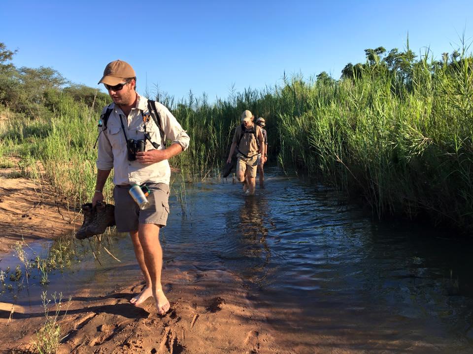 Field Guide crossing river