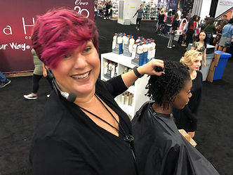 Kimberly Irene demonstrating hair at a hair show