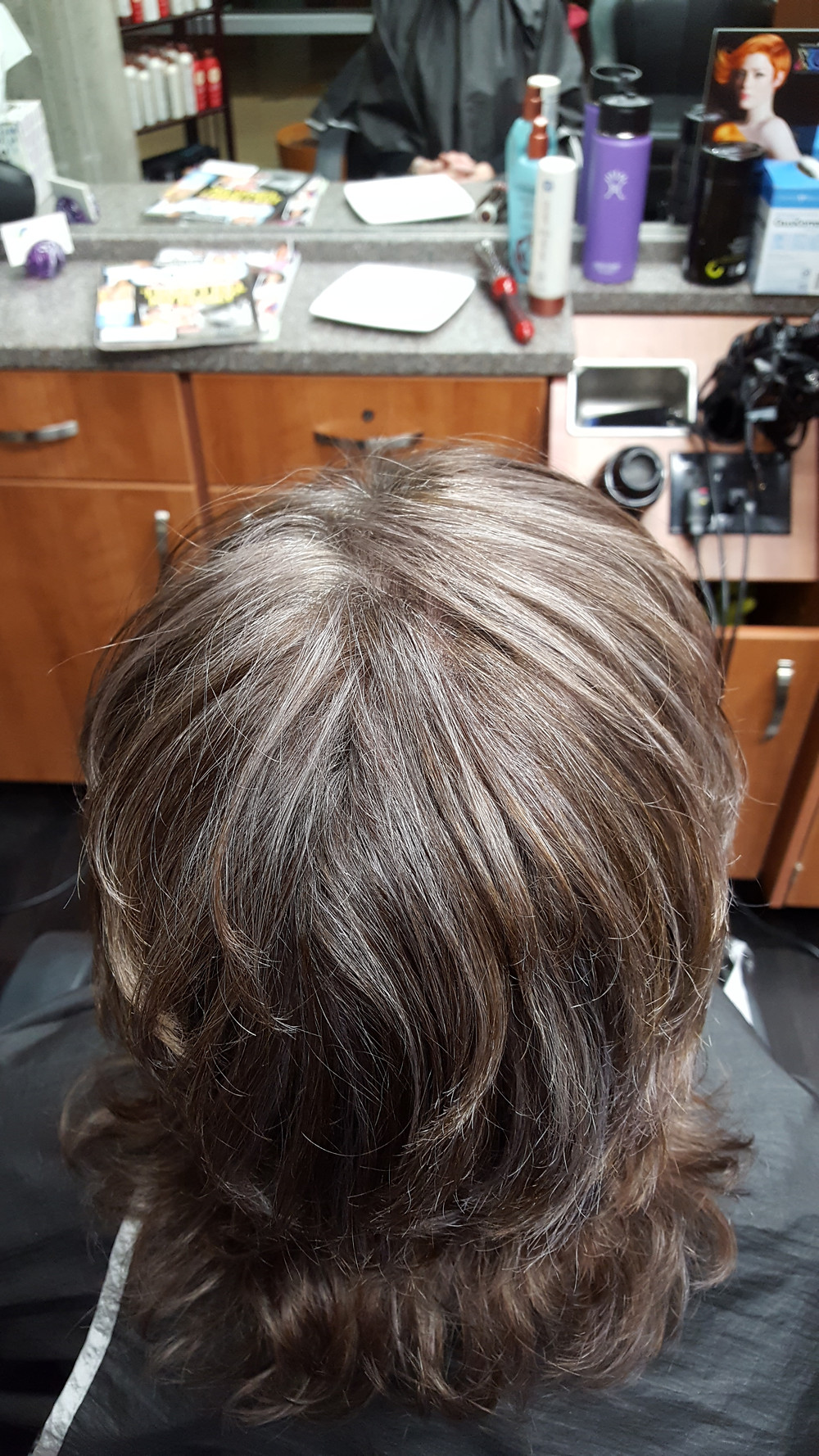 Grey hair beautifully blended with her brown hair