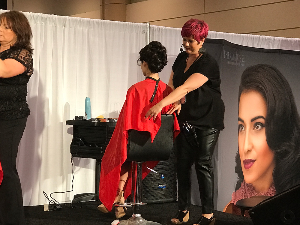 Kimberly Irene presenting at a Thermafuse hair show