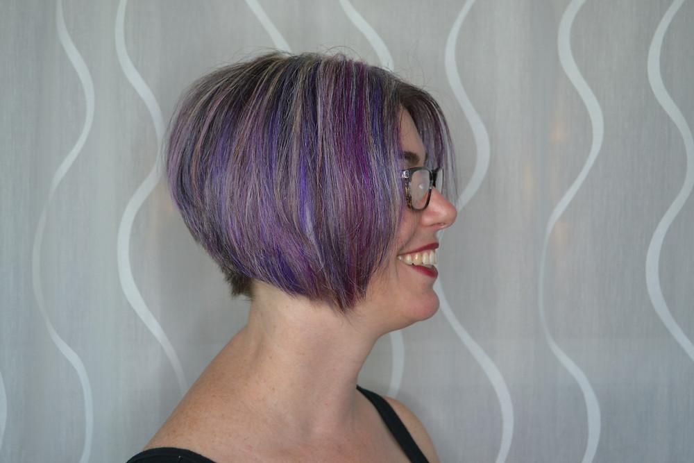 Grey hair mixed with various shades and hues of purple