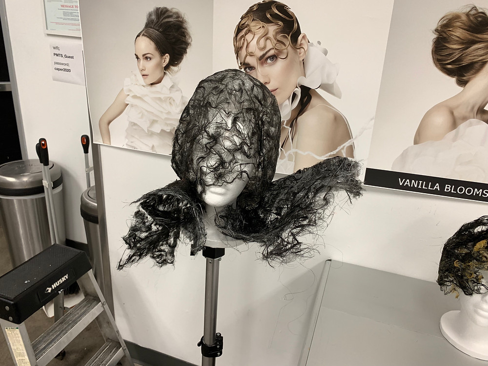 Mannequin head with a hair piece on it