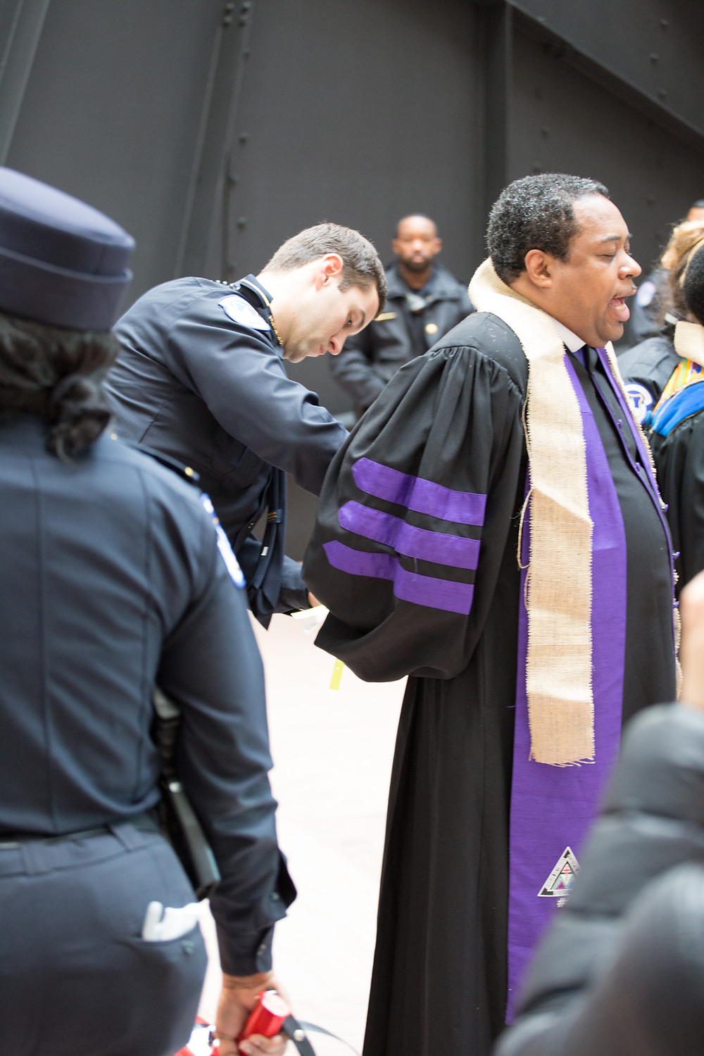 Bishop W. Darin Moore is arrested during the protest.