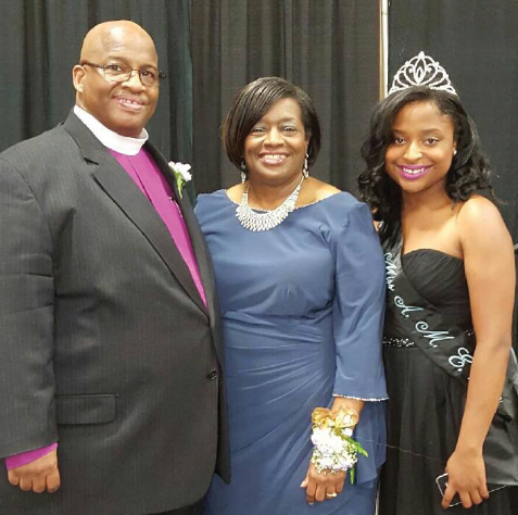 Devinae Haywood (far right) pictured with Bishop and Mrs. Darryl B. Starnes.
