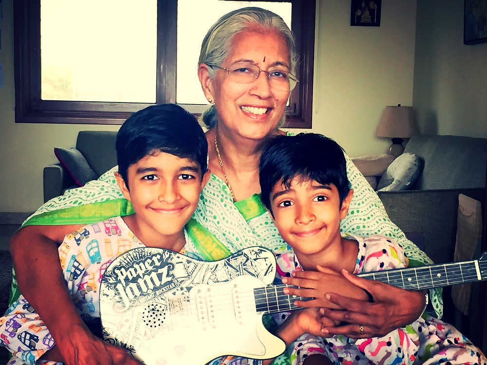 Rocking with the next generation. Amma with her grandsons
