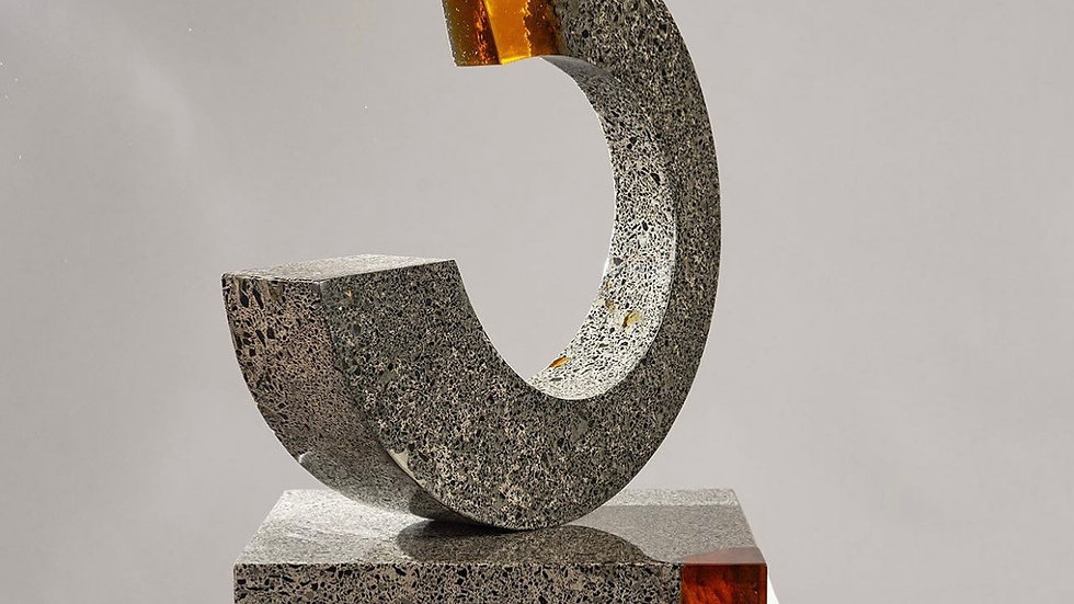 Orange resin and concrete sculpture
