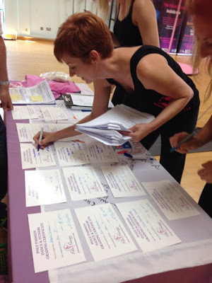 Pole Passion Bognor's Instructor - Sue Thompson marking the grading certificates