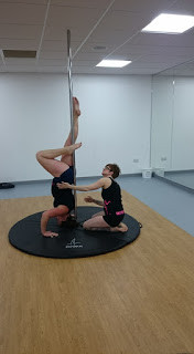 Suzanne performing a handstand with apprentice Amy at Pole Passion Bognor Inspire Leisure