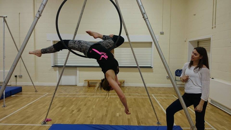 Marie performing on a hoop at Bersted Park with Paradise Fitness instructor, Angela Hawkes.