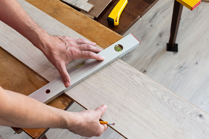 installation-laminate-or-parquet-in-the-room-worker-installing-wooden-laminate-flooring-ma