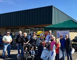 Long Lake Waters Association Membership volunteering on behalf of Water Quality at Taste of Long Lake in Summer 2017