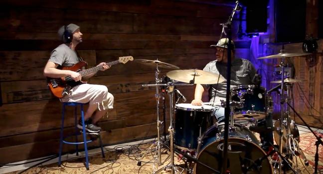 Kenny Cash and Elijah Burton tracking drums and base