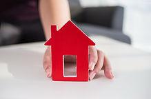 businessmen-hold-house-model-hand.jpg