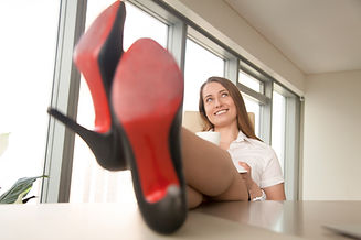 dreamy-businesswoman-relaxing-at-work-dr