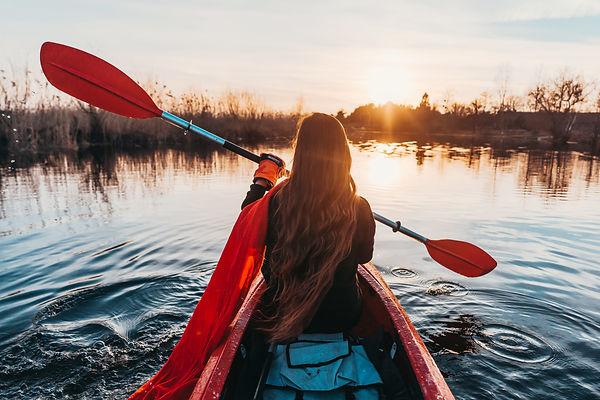 woman-holding-paddle-kayak-river.jpg