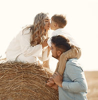 family-playing-with-baby-son-wheat-field