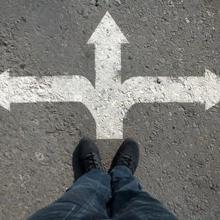 arrow on asphalt leg top view of the var