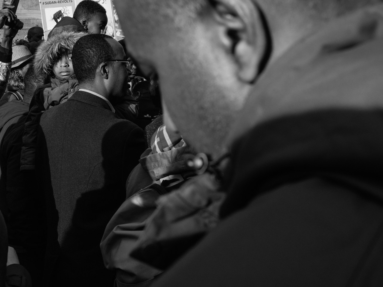 Child's eye contact at #sudan-revolts Newcastle Upon Tyne Street Photography