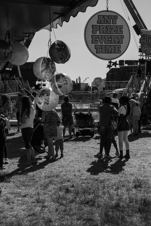 Balloon heads at The Hoppings, Newcastle Upon Tyne, Jordan Murray Street Photography.