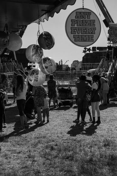 Balloon heads at The Hoppings, Newcastle Upon Tyne, Jordan Murray Street Photography.