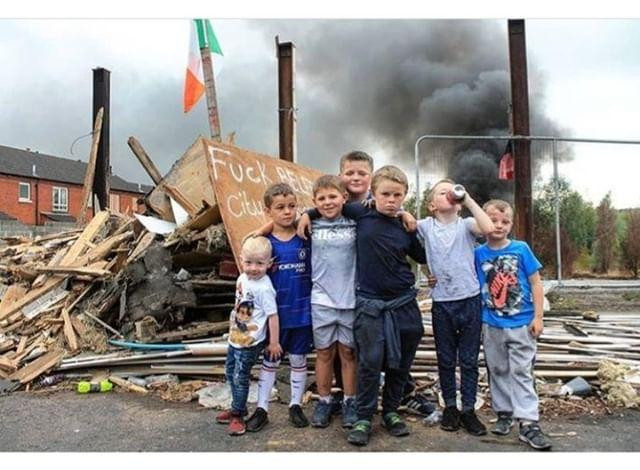 Andrew Johnston photographing gang of children at yearly bonfires in Belfast, Northern Ireland.