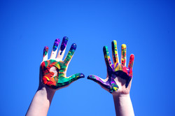 Photo of hands with rainbow paint