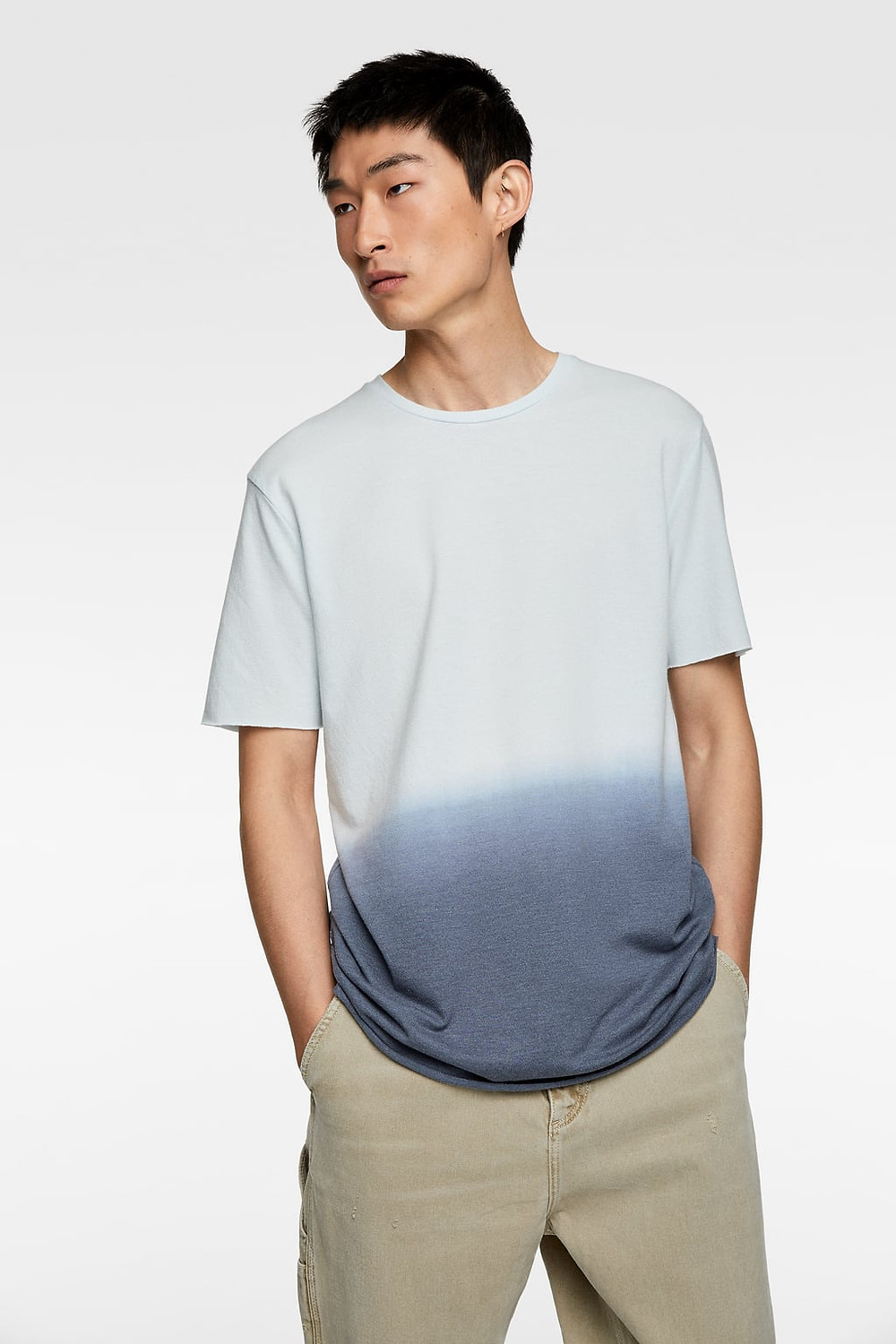 Photo of person wearing ombre t-shirt with hands in pocket