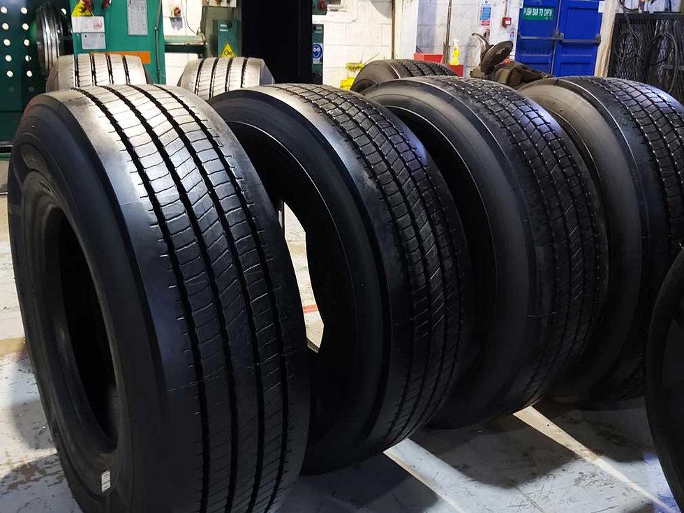 Row of newly retreaded lorry tyres