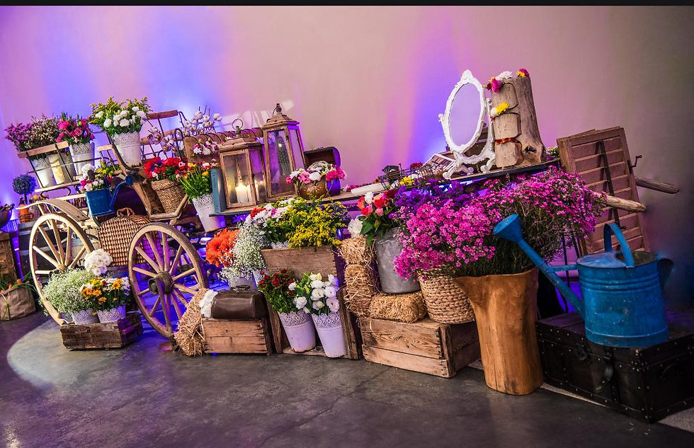 דוכן פרחים על כרכרה אירופאית.jpg
