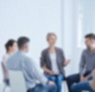 psychotherapist-and-group-PBGM4EA (1).jp