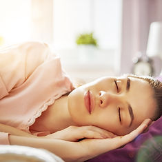 woman-sleeping-sunny-morning-PFYF7CG.jpg