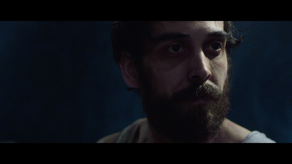 Screen Grab of Clayton Stocker Myers as Lenny Bruce in The Last of the Manson Girls