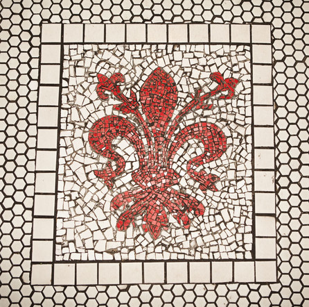 """This fleur-de-lis tile installation at the entrance to Dutch Kills was done by Jim Power (aka """"The Mosaic Man""""), who has beautified the streets of New York City's East Village with his acclaimed artwork since the 1980's.  Photo credit: Isaac Rosenthal"""