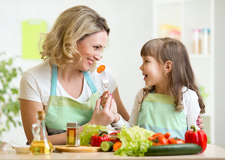 mother and daughter eating healthy