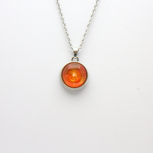 pression avec cabochon orange translucide