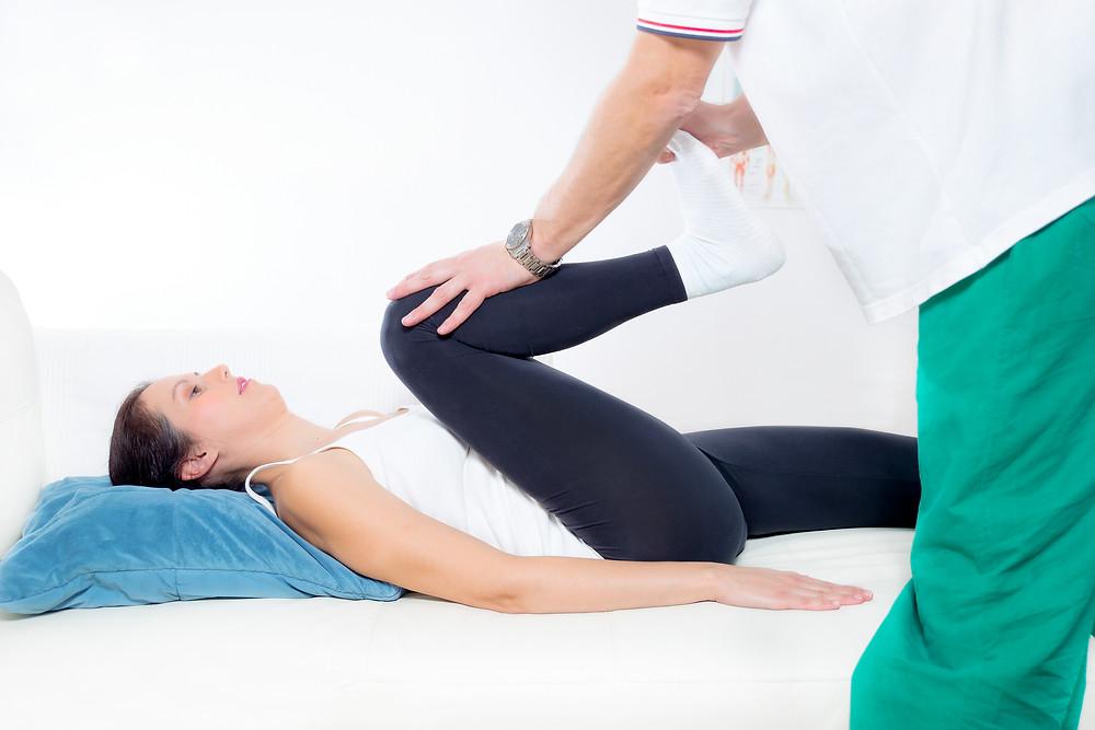 Chiropractor Works on the Patient Leg.jpg