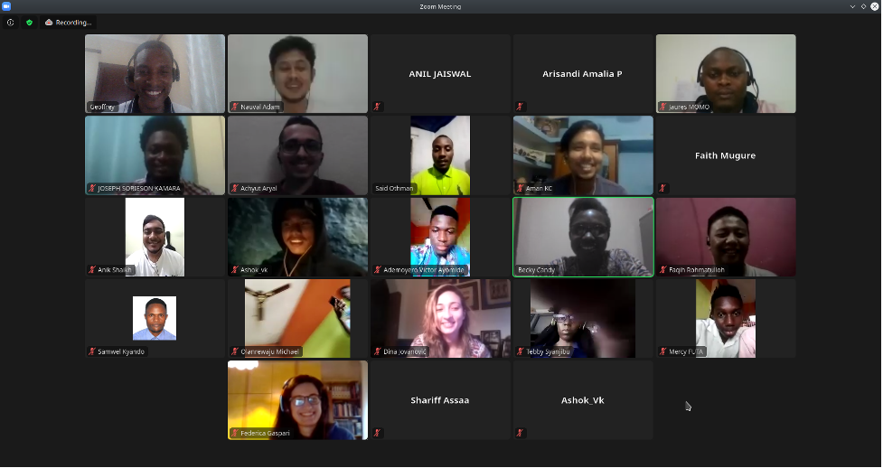 Screenshot of Zoom meeting call with 18 diverse males and females appearing on video.