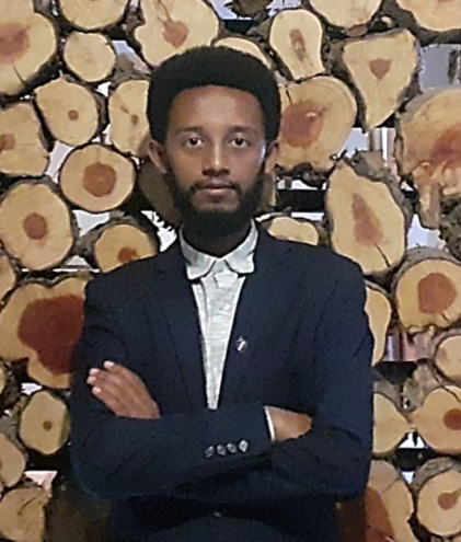 Headshot of Yared Moges in black suite jacket.