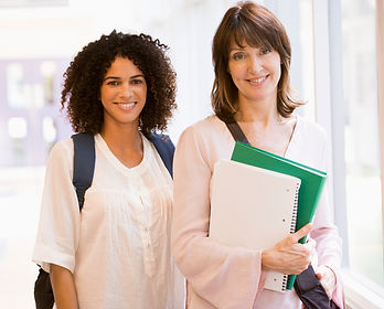 two-women-with-backpacks-standing-in-a-c