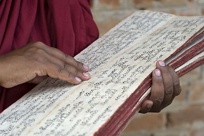 mayanmar--scriptures-being-read-by-a-bud