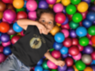young-kid-at-the-ball-pit-wearing-a-roun