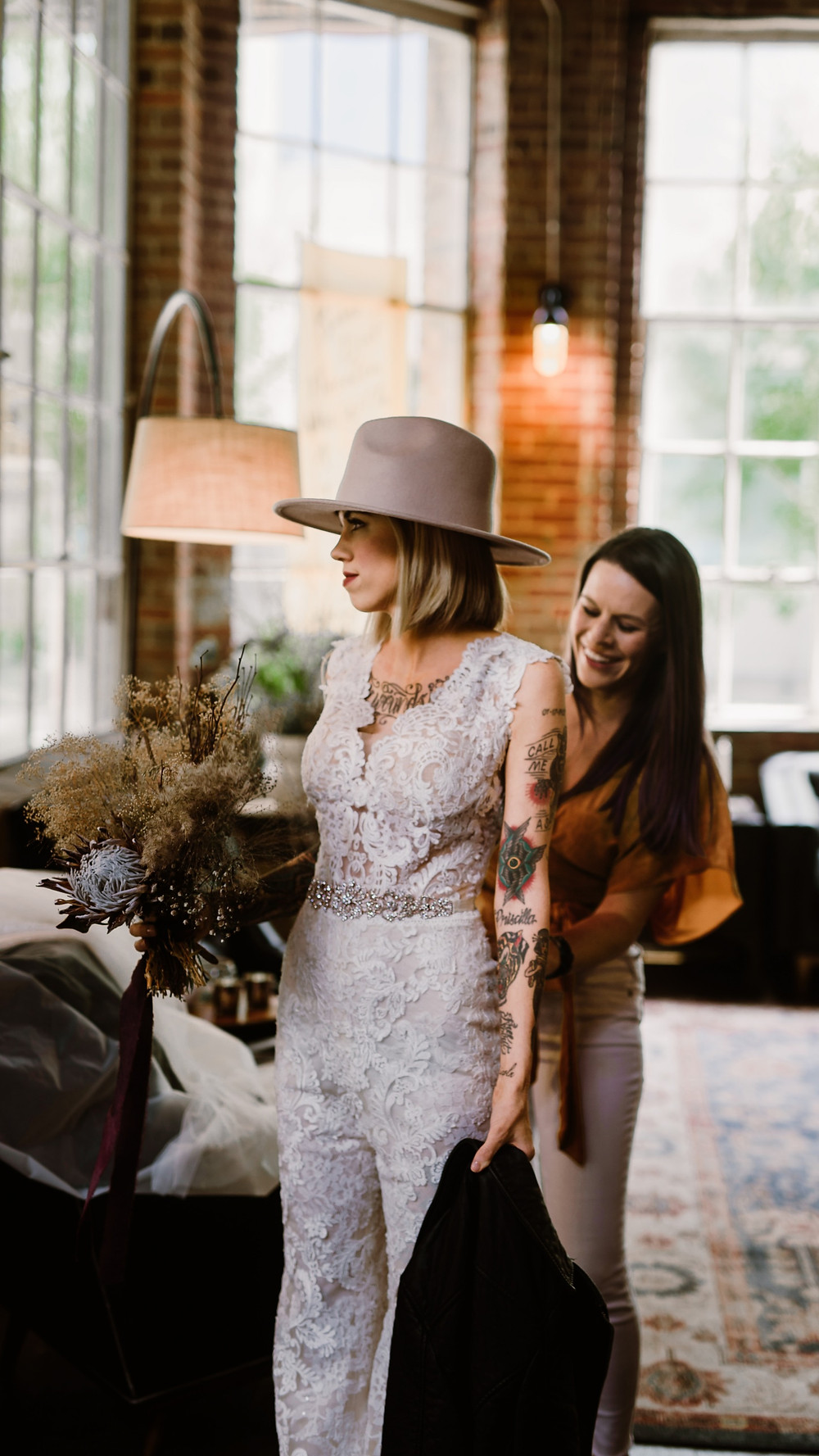 A wedding planner helping with some final details for a brides outfit
