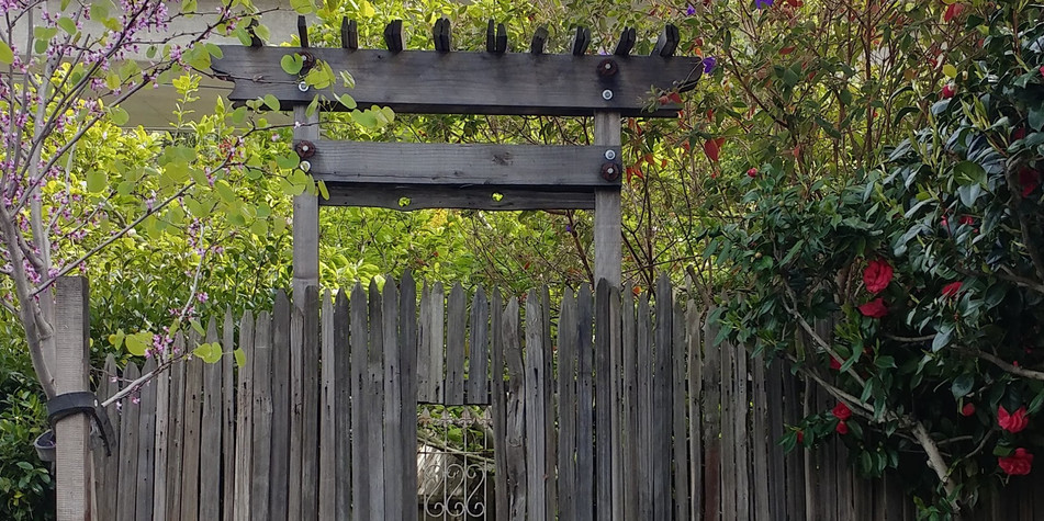 well weathered grape stakes; heirloom wrought iron detail