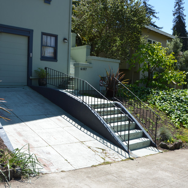 'before' view of the driveway and entry stairs