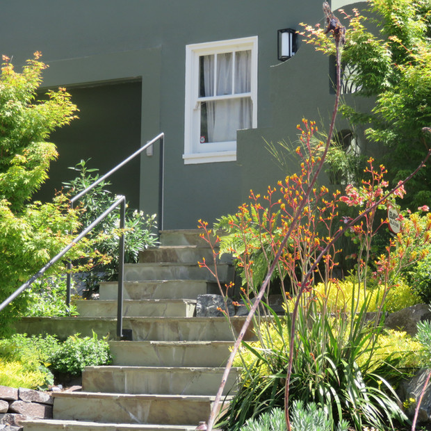 relocated front entry stairs, flagstone on concrete