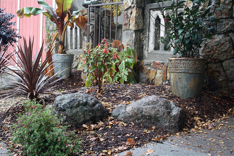 new boulders and pottery harmonize with original masonry elements