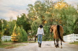 Walk at sunset with her horse Ari