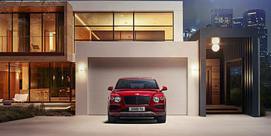 06 bentayga v8 in front of house at nigh