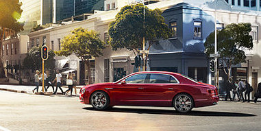 01 flying spur v8s driving through town